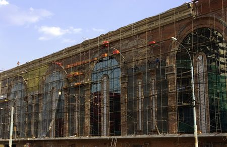 scaffolds: building under construction, with construction staging, scaffolds