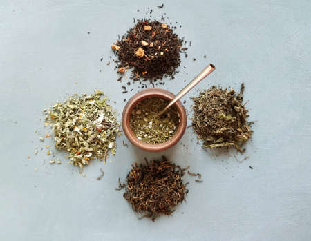 different types of dry tea, in the middle of a calabas with mate . Tea party concept