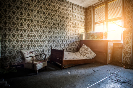 abandoned room: Abandoned room with broken bed, armchair and chest of drawers to a dry aquarium