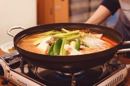 pot belly: Korean Soups Kimchichigae. Spicy Kimchi Stew Stock Photo