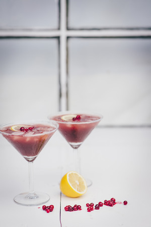 useful: Useful red cocktail in glasses of berries with lemon Stock Photo