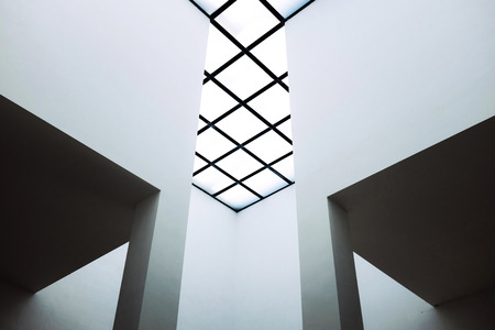 skylight: Detail of a modern skylight roof with grids in a contemporary house