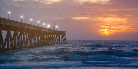 breaker: Wooden bridge and bamboo wave breaker in the sea at sunset