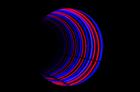 light tunnel: a closeup of abstract neon tube light tunnel