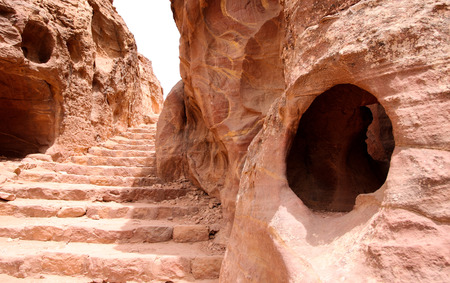 nabatean: Tombs in Little Petra - Nabataeans capital city (Al Khazneh) , Jordan. Made by digging a holes in the rocks. Roman Empire period. Stock Photo
