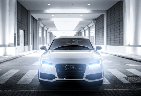 chassis: DUBAI, UAE - APRIL 15: Divine White Audi A7 S-Line with glowing lights.