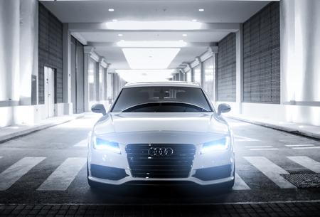 DUBAI, UAE - APRIL 15: Divine White Audi A7 S-Line with glowing lights.