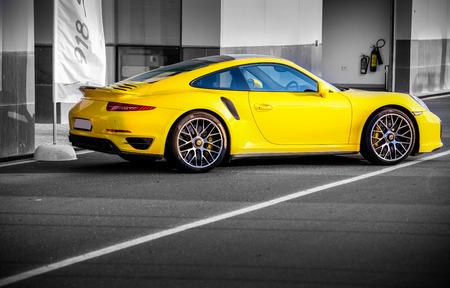 DUBAI, UAE - APRIL 15: Yellow Porsche 911 Carrera Turbo S is on the road