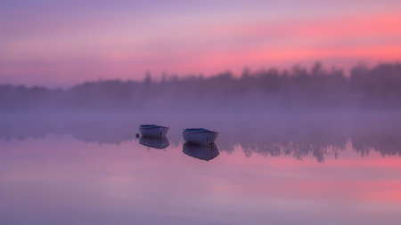 lost lake: Two boats on the river during sunset Stock Photo