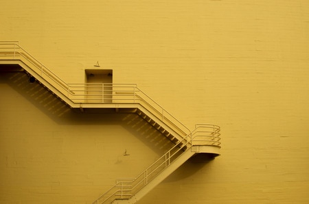 emergency stair: Stairs on a yellow building wall