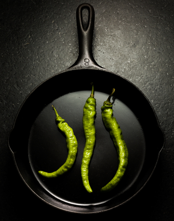 green chilli: Green chilli peppers in a pan