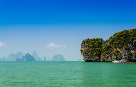 Phang Nga Bay is a 400 km? bay in the Strait of Malacca between the island of Phuket and the mainland of the Malay peninsula of southern Thailand. Since 1981.