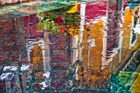 Color puddle with reflection building Stock Photo