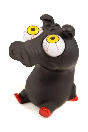 Funny pig toy (black), isolated on white background photo