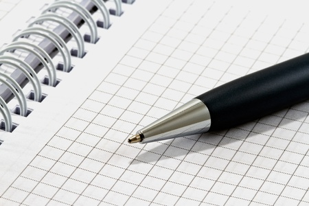 Ballpoint pen on checked notebook paper Stock Photo - 11588774