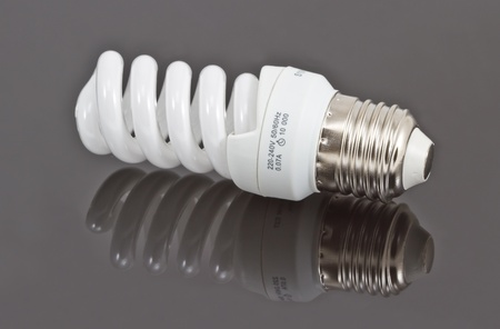 Energy saving bulb, isolated photo