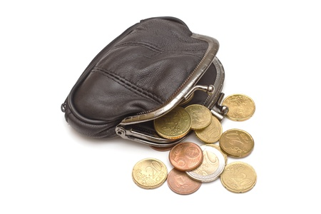 Black leather purse and several euro coins on white background photo