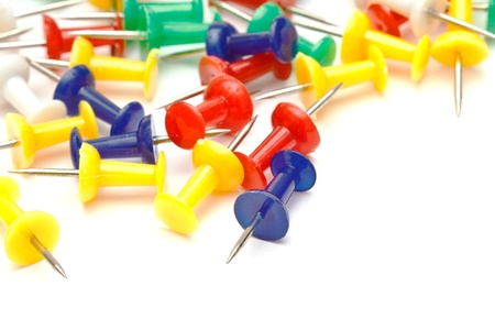 Colorful office push pins closeup on white photo