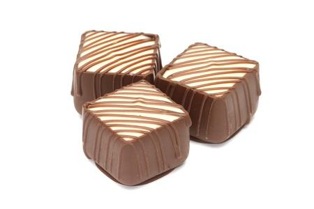 Chocolate pralines isolated on white background Stock Photo - 12826013