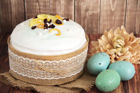 Easter composition of sweet bread, paska and eggs on wooden background. Orthodox kulich. Holidays breakfast concept Editorial