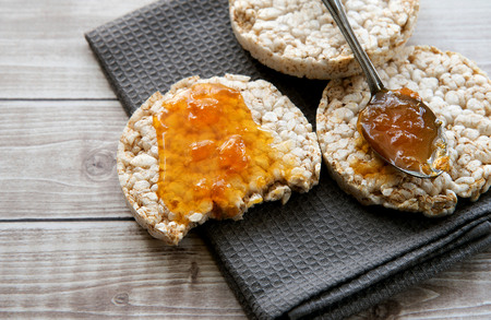 Health Breakfasts rice cakes with apricot jam Stock Photo