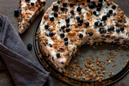 Sour cream cake with granola, biscuits and blueberries Stock Photo