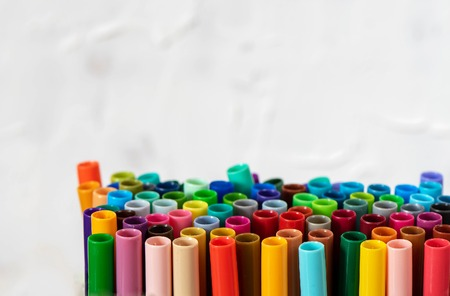 A set of colorful markers, with a place for copy space on white background.