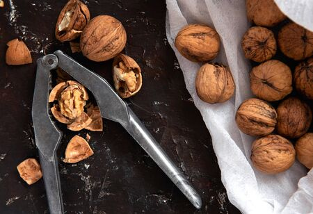 walnuts and nutcracker on a dark background.