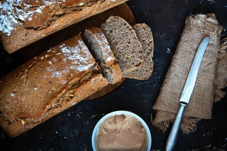 Freshly baked whole grain bread sliced and pate.