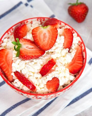 Cottage cheese with strawberries and sour cream. Healthy dessert. Top view.