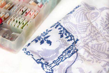 A close up of a cross stitch embroidery. Cross-stitch ornament.