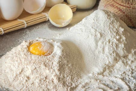 Preparation of the dough. The egg with the flour. Top view.