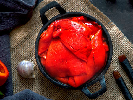 Tasty roasted red bell peppers in pan.