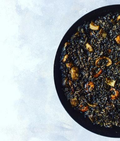 Black rice Paella in pan