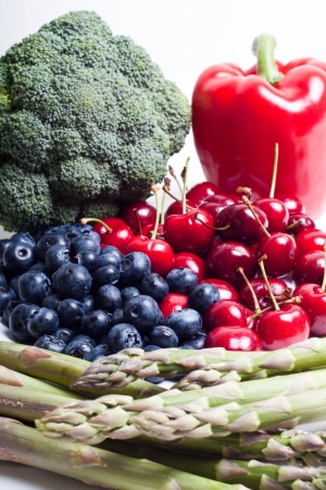 brocoli: brocoli, red pepper, cherries, blueberries and asparagus
