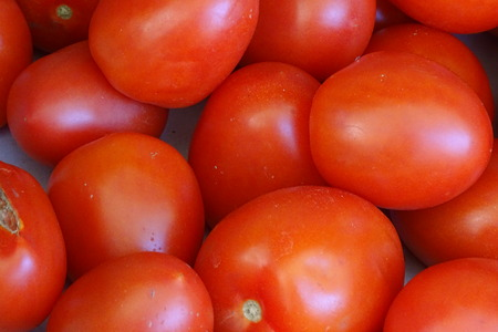 Red tomatoes in detail as a background Stock Photo