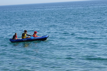 Family with kayak on the sea, summer sports