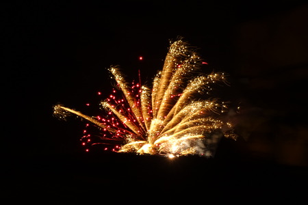 darck: Fireworks at night, colorful lights in the darkness Stock Photo