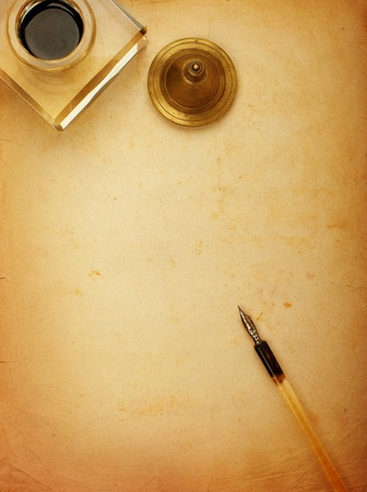 writing utensil: Fountain pen and inkwell and old paper