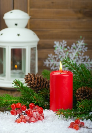 Christmas red candle and spruce branches photo