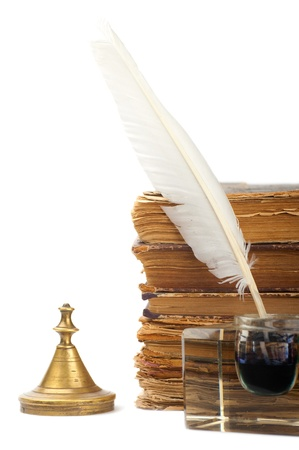 inkstand: Pen in the inkstand and old books Stock Photo