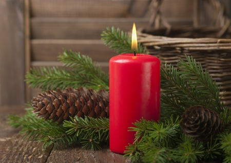 adorn: Christmas red candle and spruce branches