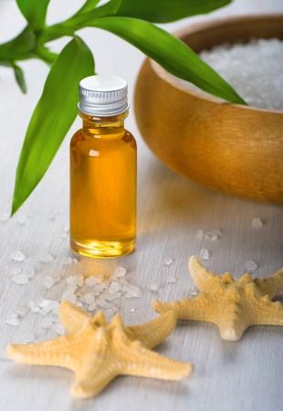 Essential oil and sea salt. Aromatherapy photo