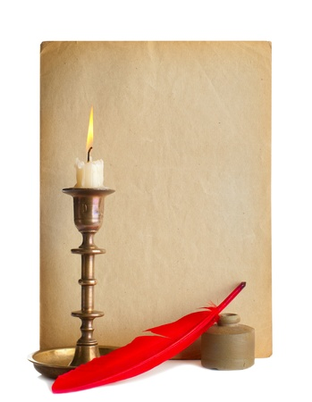 Red pen and ink and candle and old paper photo