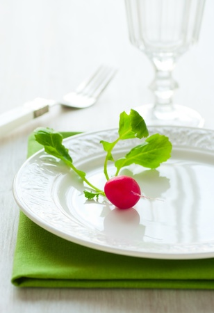 Diet  A little radish on a plate photo