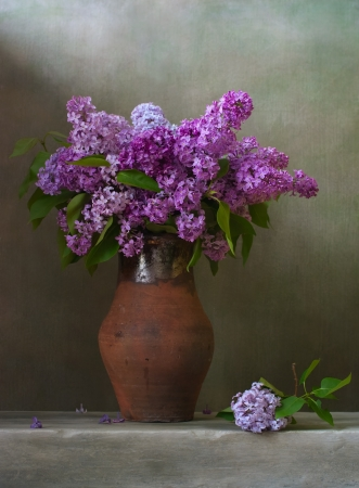 Bouquet of lilacs in a brown jug photo