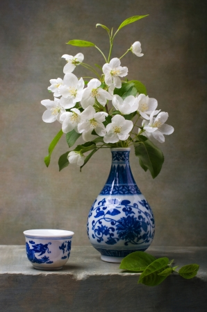 Apple flowers in a chinese vase photo