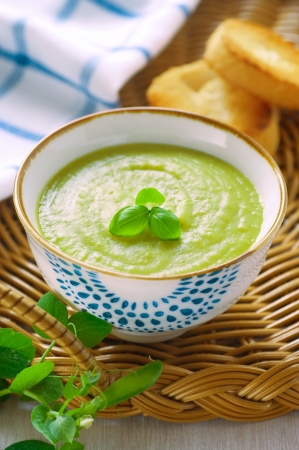Fresh green pea soup on a tray photo