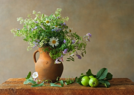 Still life with wildflowers and green apples photo