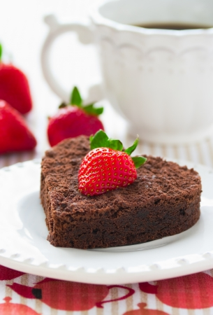 Chocolate cake with strawberries photo